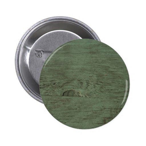 Fondo de madera teñido verde del grano pins