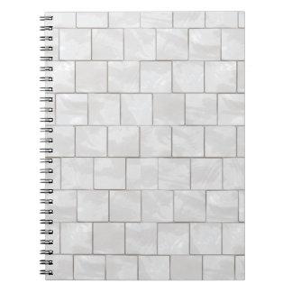 Fondo de mármol decorativo blanco de la teja libros de apuntes con espiral