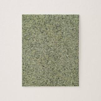 Fondo de mármol gris manchado de la textura puzzle con fotos