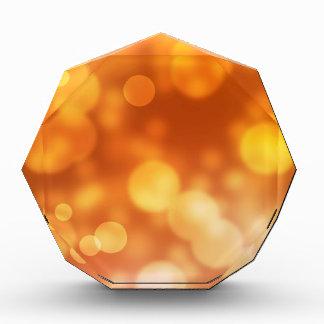 Fondo de oro del bokeh de las luces anaranjadas de