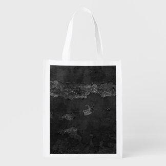 Fondo de papel dañado rasgado negro bolsas de la compra