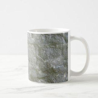 Fondo de piedra gris de la textura de Rockwall Tazas