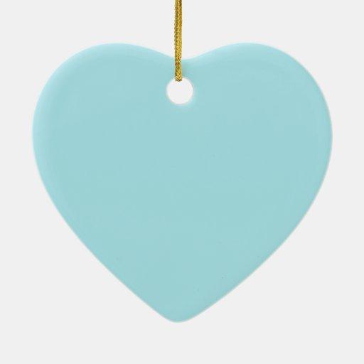 Fondo del azul de la ventisca adorno navideño de cerámica en forma de corazón