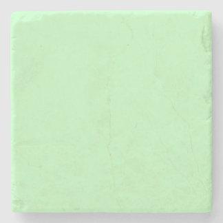 Fondo del color en colores pastel del verde azul posavasos de piedra