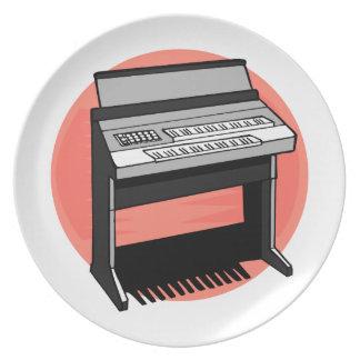 Fondo del melocotón del órgano eléctrico platos para fiestas