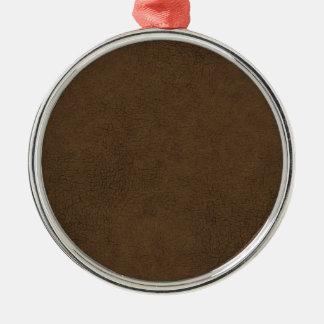 Fondo del modelo de la textura del cuero marrón adorno redondo plateado