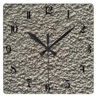 Fondo del muro de cemento reloj cuadrado