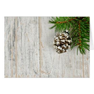 Fondo del navidad con los ornamentos en rama