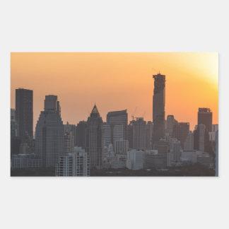 Fondo del panorama de la puesta del sol del pegatina rectangular
