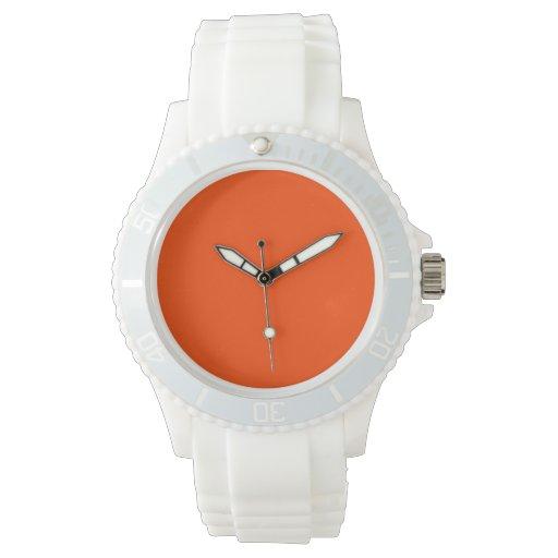 Fondo del rojo anaranjado relojes de mano