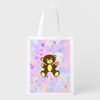 Fondo en colores pastel de la mariposa con el oso bolsa de la compra