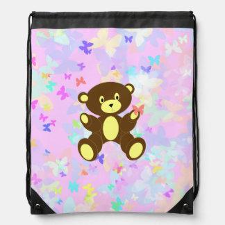 Fondo en colores pastel de la mariposa con el oso mochilas