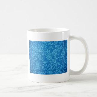 Fondo floral azul taza de café