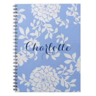 Fondo floral blanco elegante del azul de las cuaderno