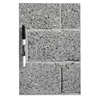 Fondo gris de la pared de ladrillo pizarra blanca