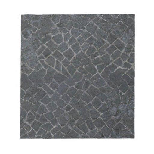 Fondo gris de la textura de la trayectoria de la r blocs de notas