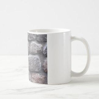 Fondo gris de pared de piedra taza clásica