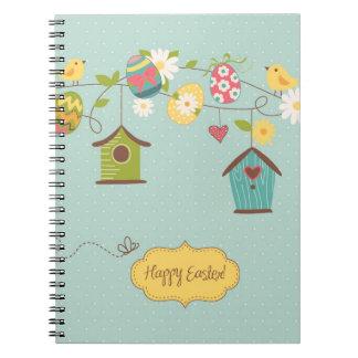 Fondo hermoso de la primavera con las casas del pá spiral notebooks