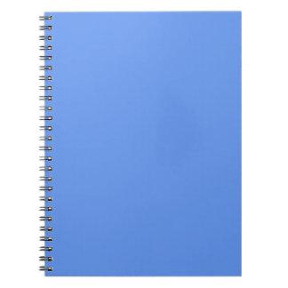 Fondo ligero del color sólido de los azules cielos spiral notebooks