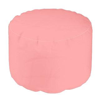Fondo ligero del sólido del rosa de color salmón puf redondo