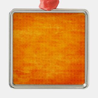 Fondo ligero sucio anaranjado brillante adorno navideño cuadrado de metal