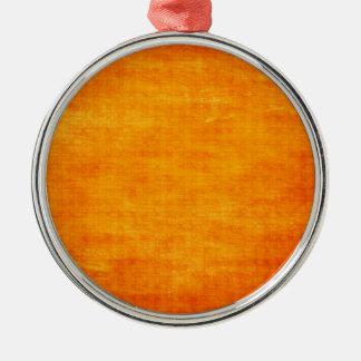 Fondo ligero sucio anaranjado brillante adorno navideño redondo de metal