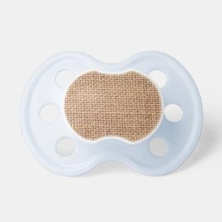 Fondo marrón claro del saco de la arpillera chupetes para bebes