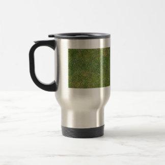 Fondo mezclado hermoso de la hierba tazas de café