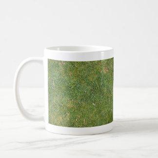 Fondo mezclado hermoso de la hierba taza de café