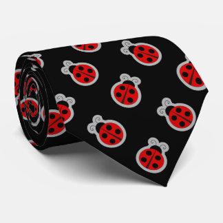 Fondo negro de la mariquita corbatas