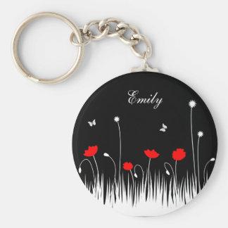 Fondo negro de las amapolas rojas llavero redondo tipo pin