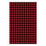 Fondo negro de los lunares y puntos rojos papelería