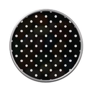 Fondo negro de los pequeños lunares blancos latas de caramelos