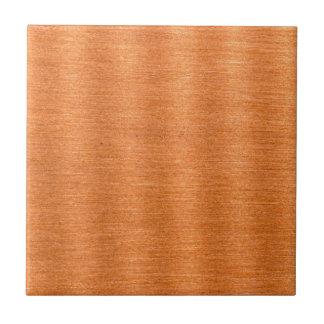 Fondo ondulado de cobre pulido de la textura azulejo cuadrado pequeño