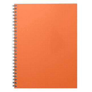 Fondo personalizado naranja del color de la libro de apuntes con espiral