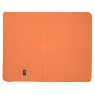 Fondo personalizado naranja del color de la cuadernos
