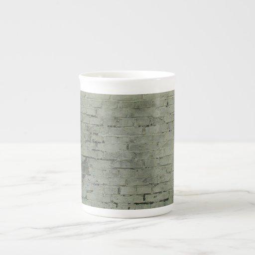 Fondo pintado gris de la textura de la pared de la tazas de porcelana