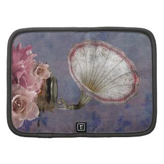 Fondo retro del fonógrafo floral rosado del vintag organizador
