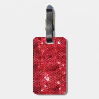 Fondo rojo de la imagen de la lentejuela etiqueta de equipaje