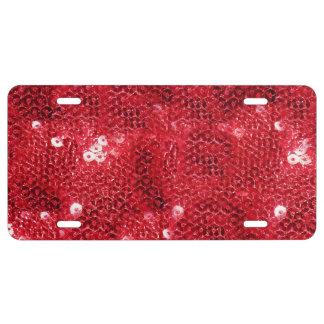 Fondo rojo de la imagen de la lentejuela placa de matrícula