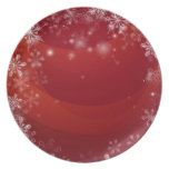 Fondo rojo de la nieve del navidad plato