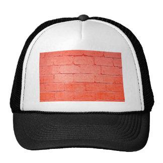 Fondo rojo de ladrillos con una capa de pintura gorra