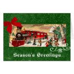 Fondo rojo del verde del motor del tren del navida tarjetón