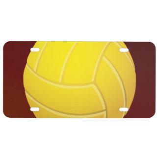 Fondo rojo terroso del voleibol amarillo placa de matrícula