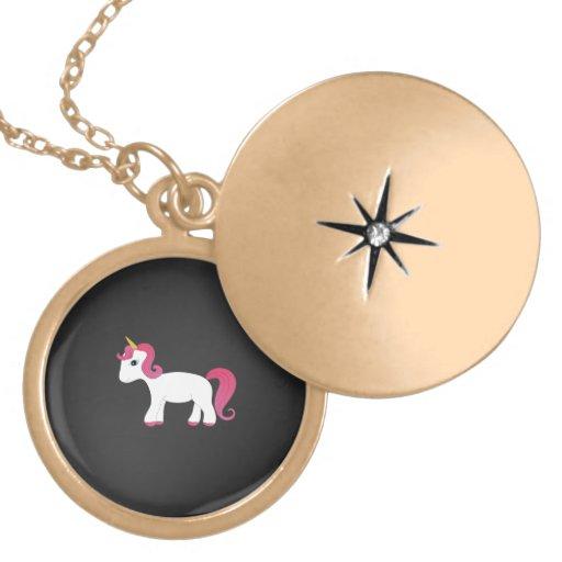Fondo rosado del negro del unicornio del pelo medallón