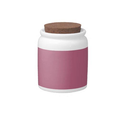 Fondo rosado en un tarro del caramelo jarra para caramelo