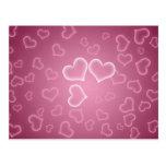 Fondo rosado lindo de los corazones postales