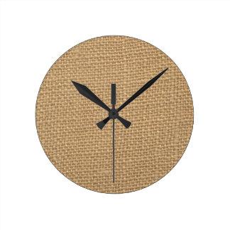 Fondo rústico de la arpillera impreso relojes