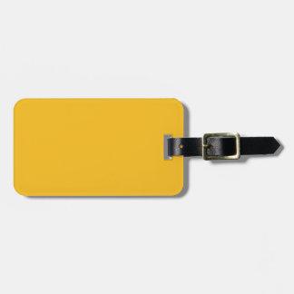 Fondo sólido del color de la tendencia del amarill etiquetas de equipaje