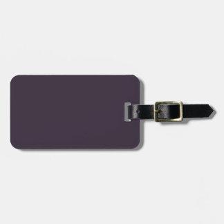 Fondo sólido púrpura oscuro del color de la tenden etiqueta de maleta